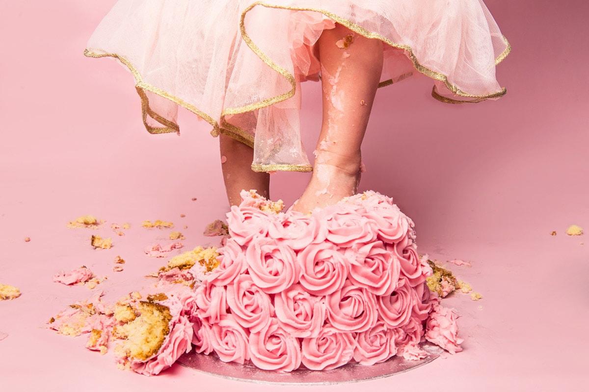 Girl stamps on cake