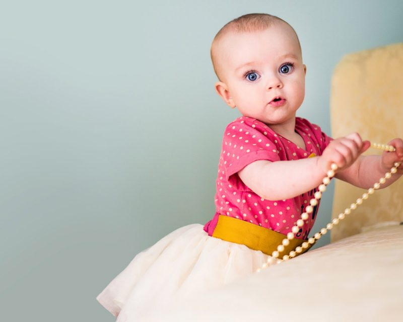 Girl standing with pearls