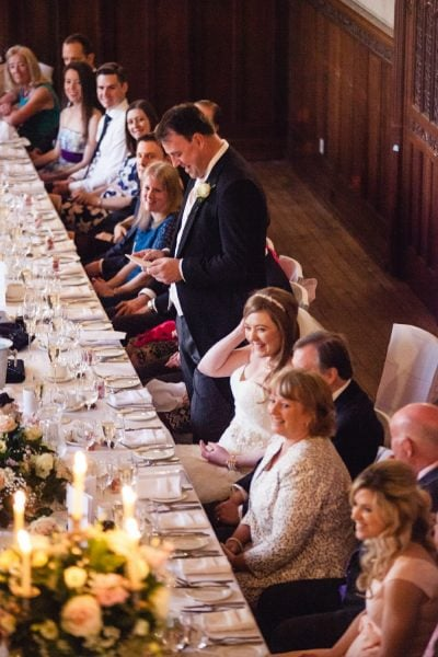 guests laughing at grooms speech