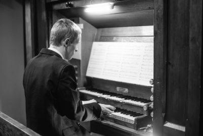 man-playing-church-organ