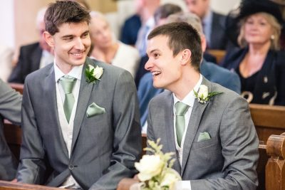 groom laughing with best man church wedding