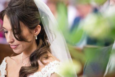 candid bridal portrait during wedding ceremony