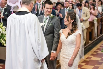 bride and groom looking at eachother