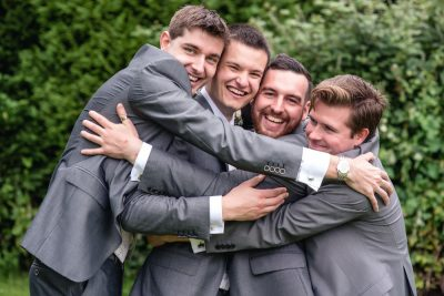 fun wedding photographer reading group portrait