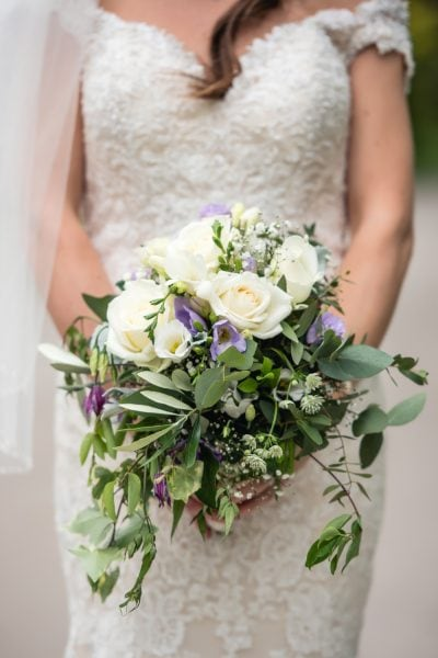 close up of rustic ivory and purple bouquet
