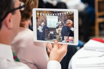 guest filming wedding speeches