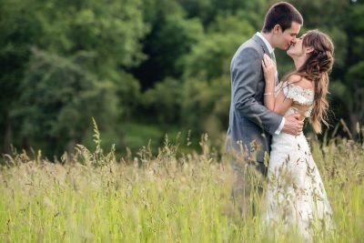 wedding couple portrait in long grass