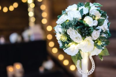 white floral centrepieces with fairylights