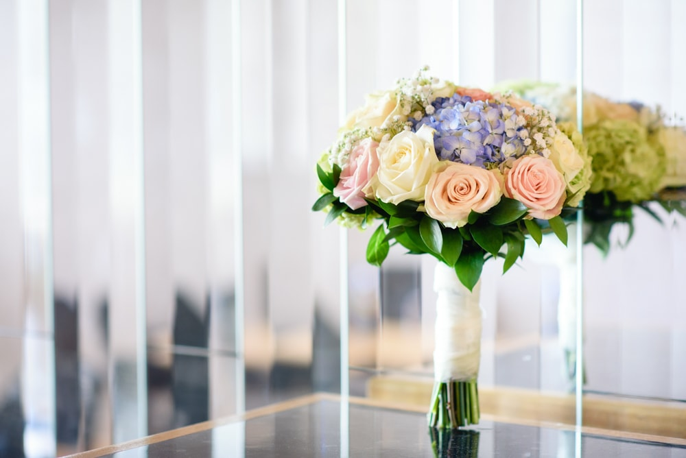 Pastel bouquet with pink peach and ivory flowers